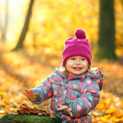 picture of child enjoying Autumn leaves
