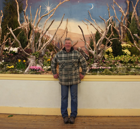 Richard Bramley in front of one his garden displays.